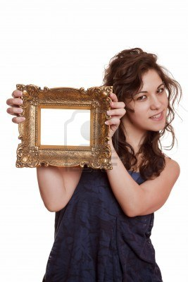 5283498-beautiful-woman-holding-an-picture-frame